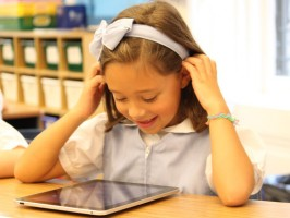 Student at the Marymont School of New York uses school-issued iPad