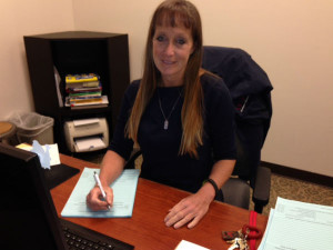 Mrs. Christine Dancey helps keep CCHS running
